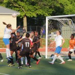 Cat Whitehill goes up for a header on a corner kick. (Photo Copyright: Meg Linehan)