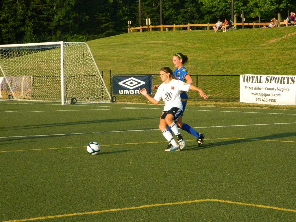 DC United Women's Ashley Herndon and Northern Virginia's Alyson Gregorowicz battle for the ball. (Photo Copyright: Jennifer Gordon)