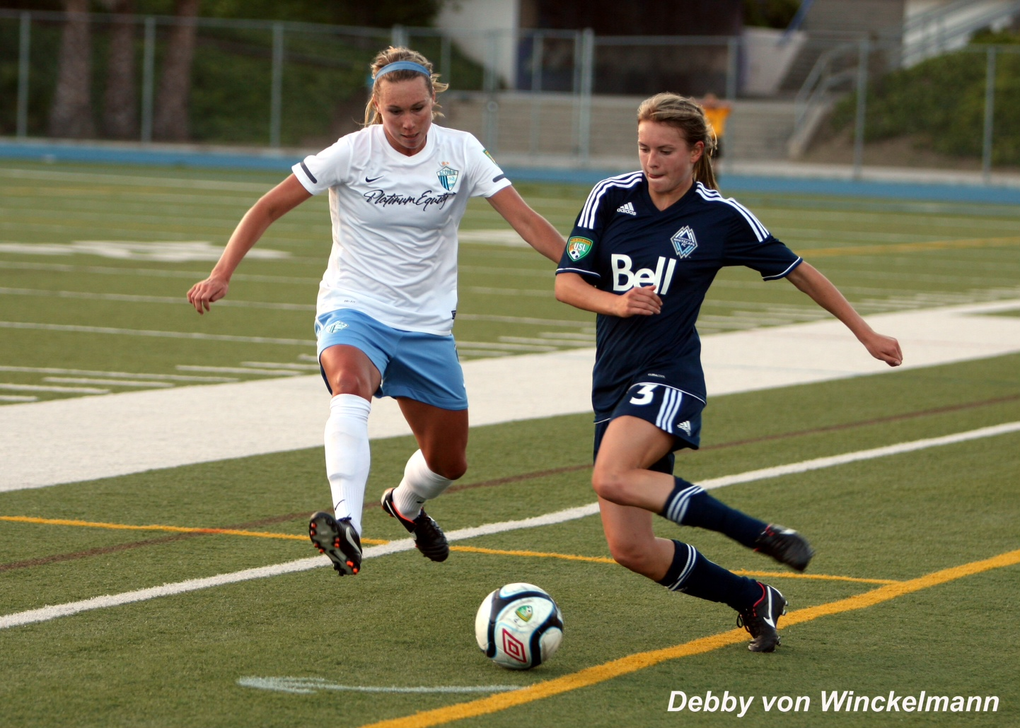 Whitney Engen (left with Pali Blues) will be the main building block of the Houston Dash defense. (Photo Copyright: Debby von Winckelmann)