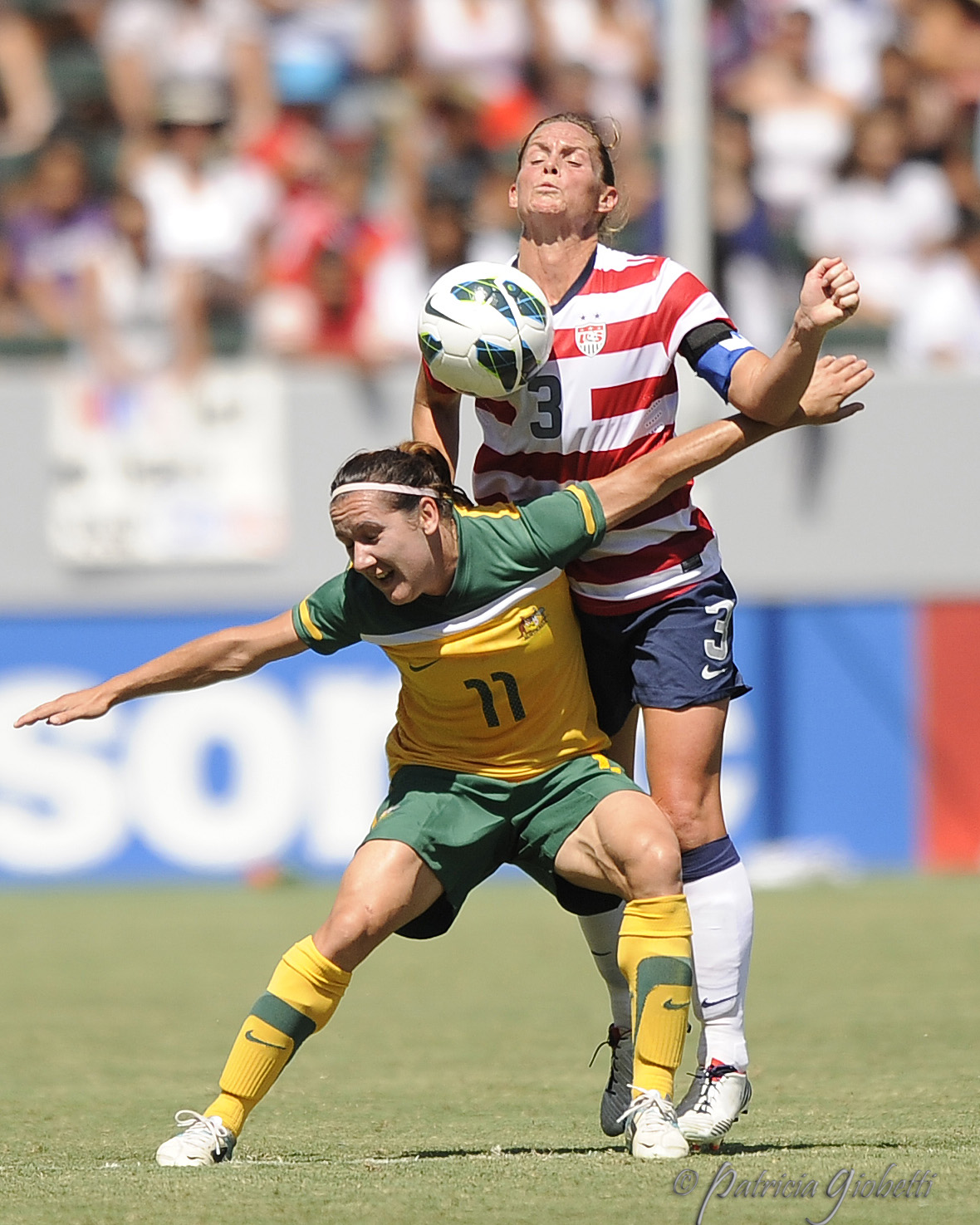 Lisa DeVanna (left) of Australia battles U.S. captain Christie Rampone for the ball. (Copyright Patricia Giobetti | http://www.printroom.com/pro/psgiobetti)