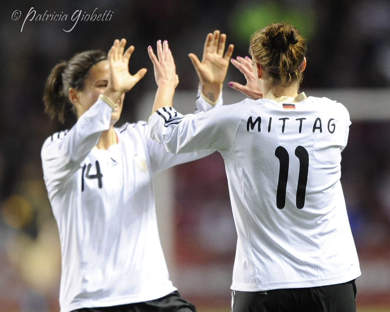 Dzsenifer Marozsan (left) and Anja Mittag celebrate Mittag's goal