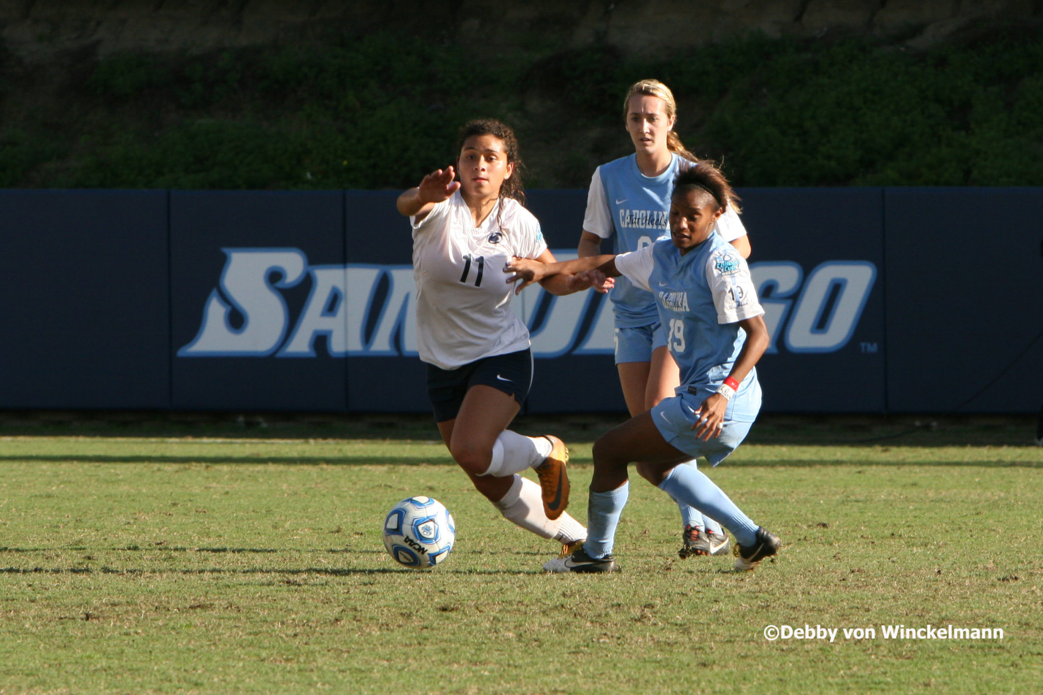 UNC's Crystal Dunn (right, No. 19) won the 2012 MAC Hermann Trophy. (Photo copyright Debby von Winckelmann for EqualizerSoccer.com)