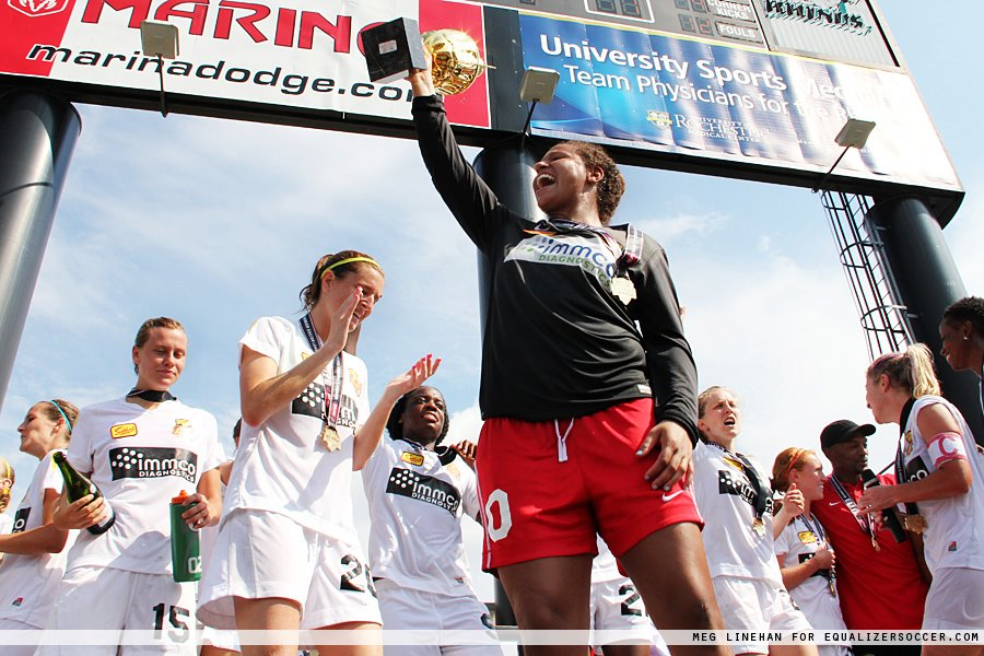 Goalkeeper Brittany Cameron lifts the 2012 WPSL Elite League trophy with the Western New York Flash. (Photo Copyright: Meg Linehan)