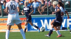 Reign hold on to tie Flash in Rapinoe's debut