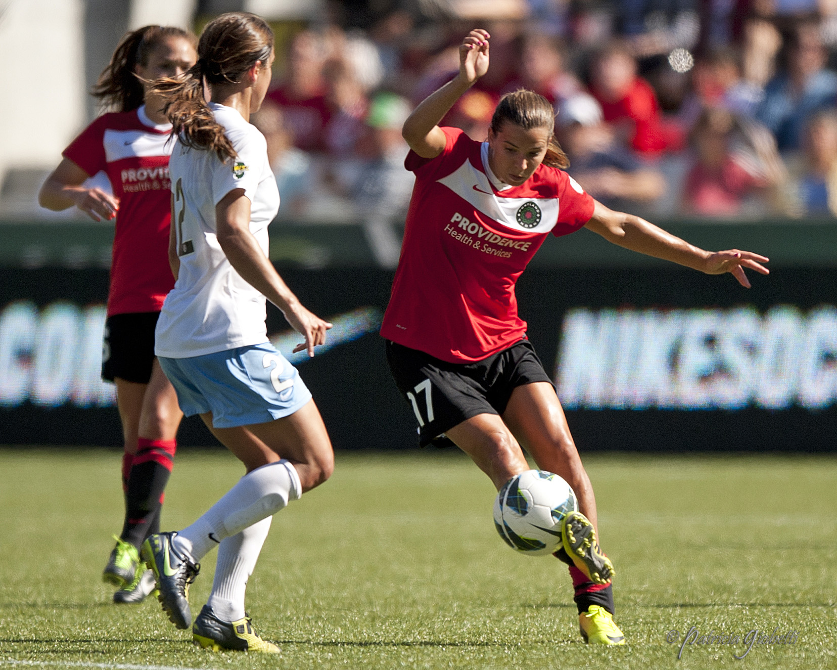Tobin Heath could have been sent off Sunday for her tackle on Lori Chalupny. (Photo Copyright Patricia Giobetti | http://www.printroom.com/pro/psgiobetti)