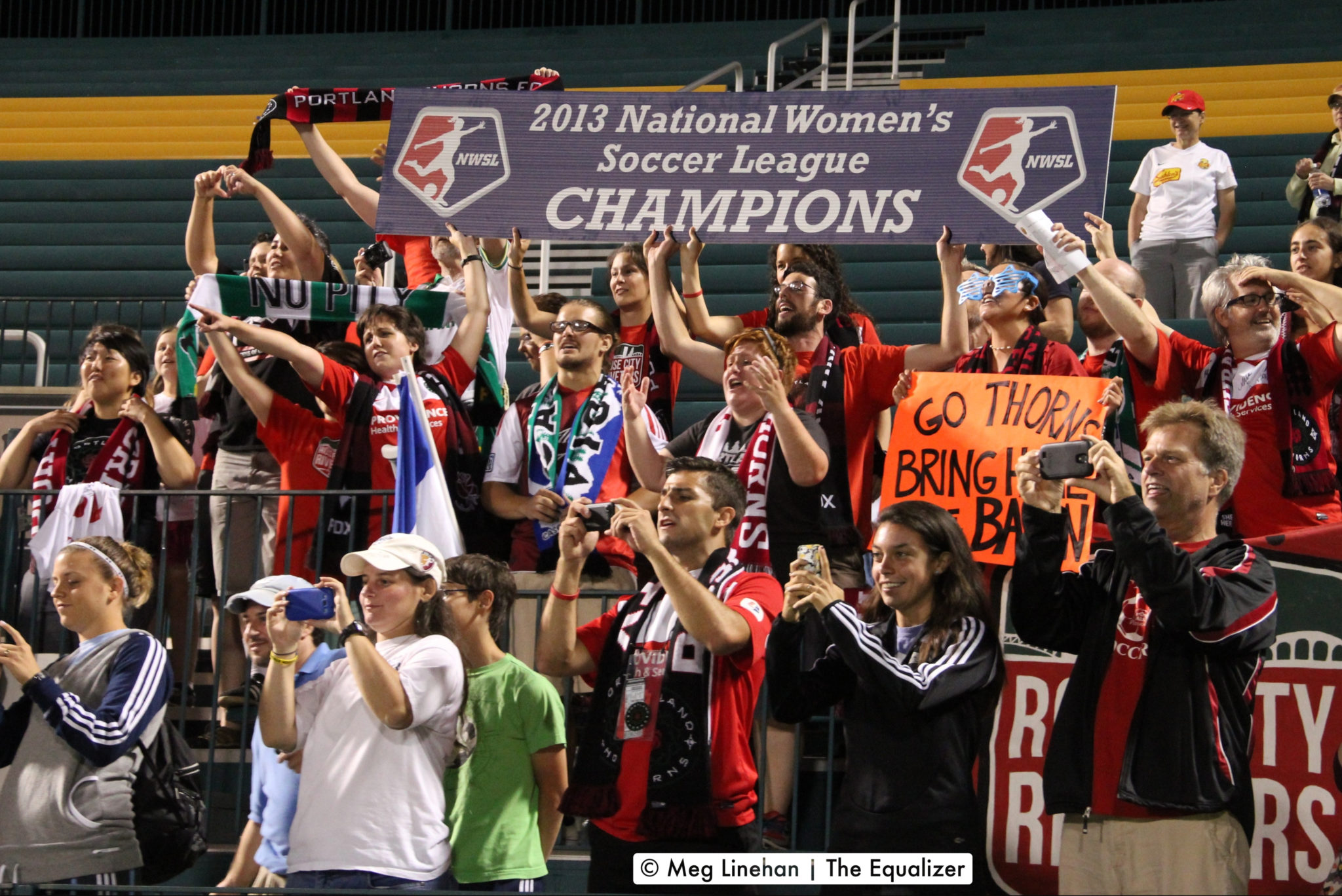 The Rose City Riveters celebrate Portland Thorns FC's win at the 2013 NWSL Championship (photo copyright Meg Linehan for The Equalizer.)