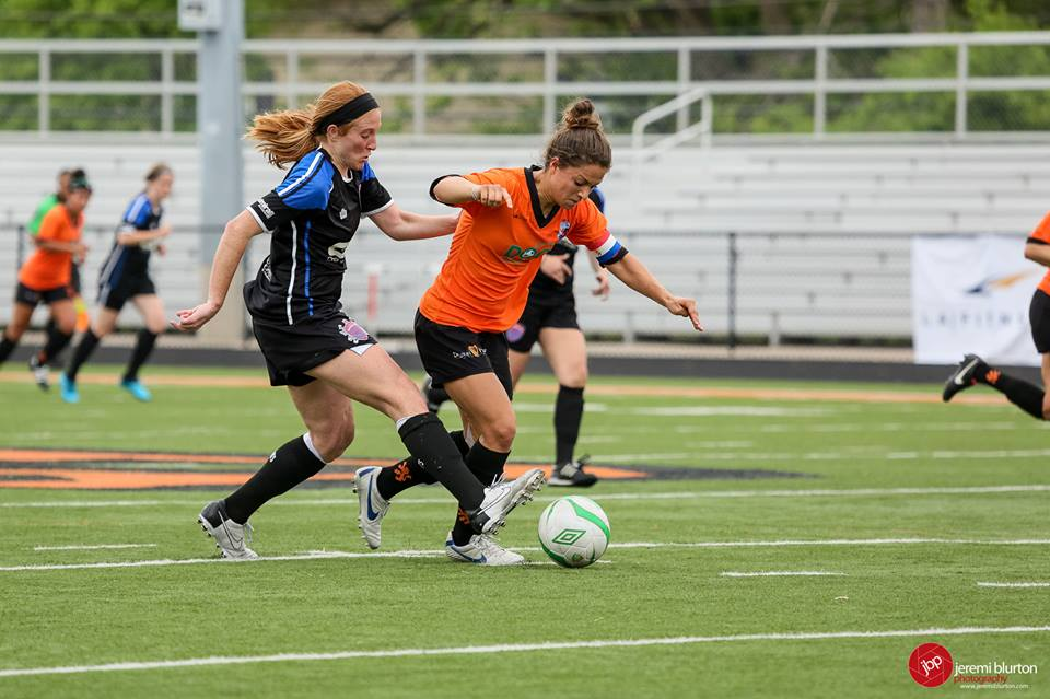 Emilie Fillion (orange) dribbles away from pressure with the Dayton Dutch Lions. (Photo Courtesy Koen Driessen of the Dayton Dutch Lions)
