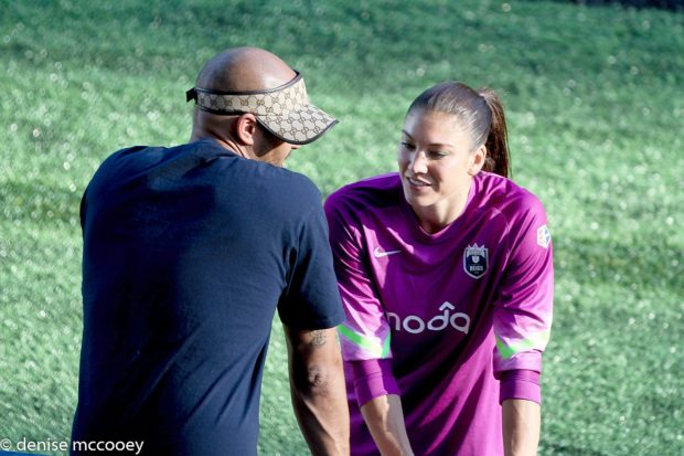 Hope Solo, here with hisband Jerramy Stevens, wants to play in the next World Cup. (Photo Copyright Denise McCooey/Prost Amerika)