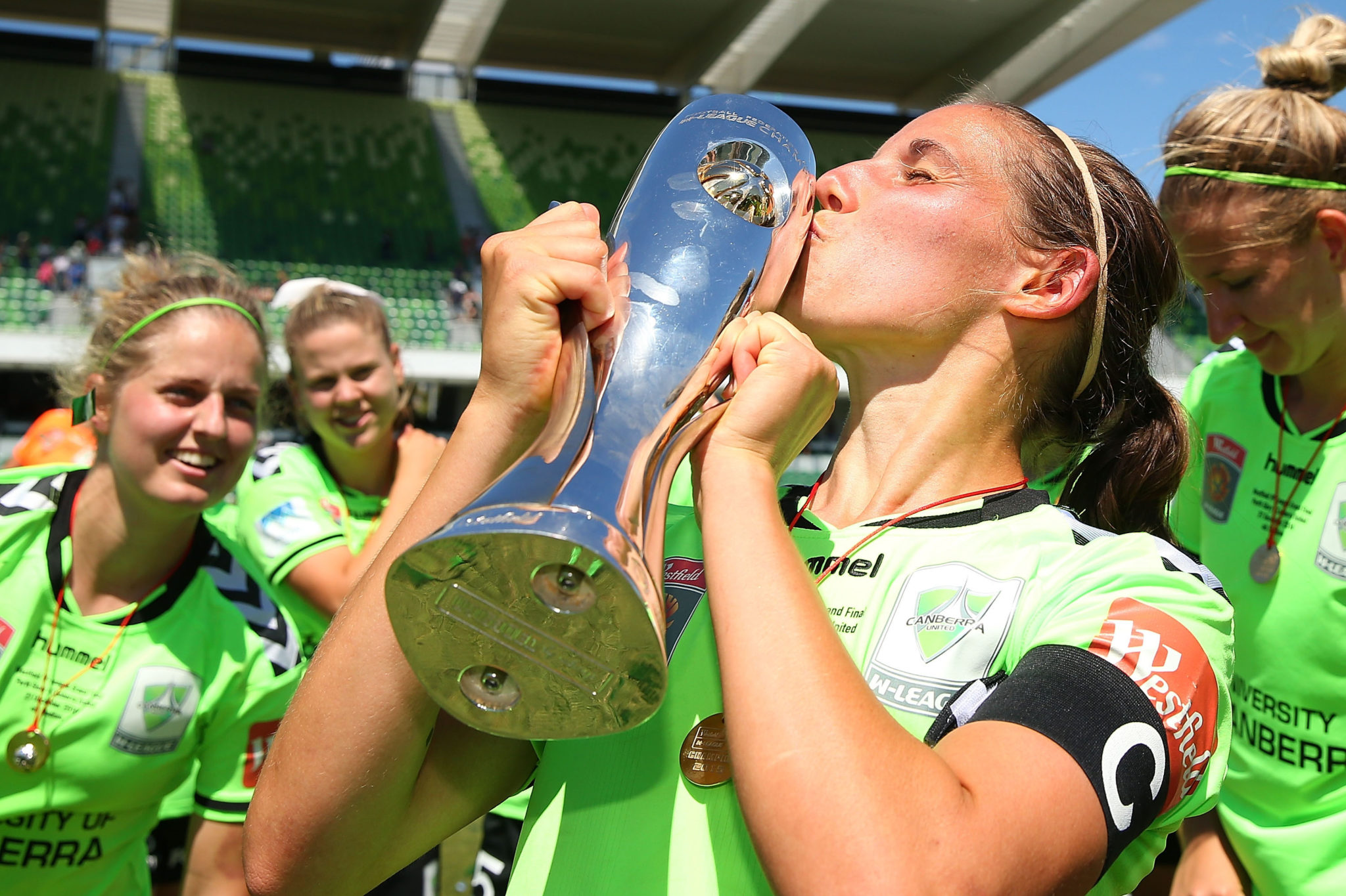 Canberra captain Nicole Begg kisses the trophy after United beat Perth Glory in the Westfield W-League Grand Final. (Getty Images)