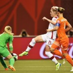 Loes Geurts (green) playing against Canada during Group A play. (Getty Images)