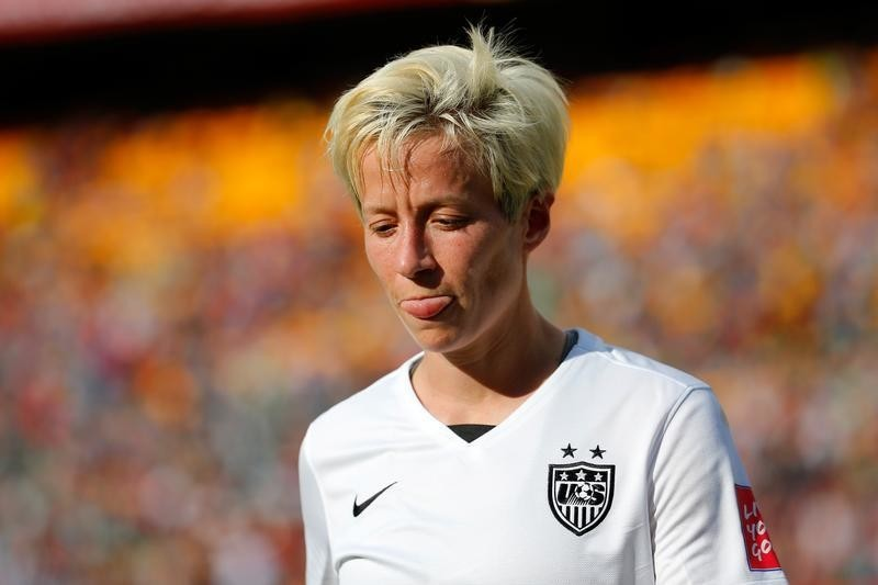 Megan Rapinoe reacts to the yellow card that got her sat down for Friday's quarterfinal. (Getty Images)