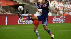 Japan opens title defense by edging Switzerland, 1-0