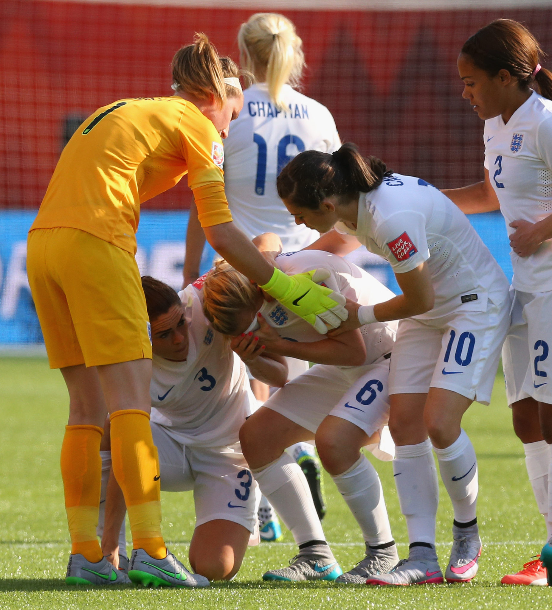 Laura Bassett (6) is consoled by teammates in the moments after her own goal cost England a chance to advance to the World Cup final. (Getty Images)