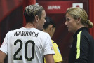 After WC title, Wambach, Ellis face Olympics decisions