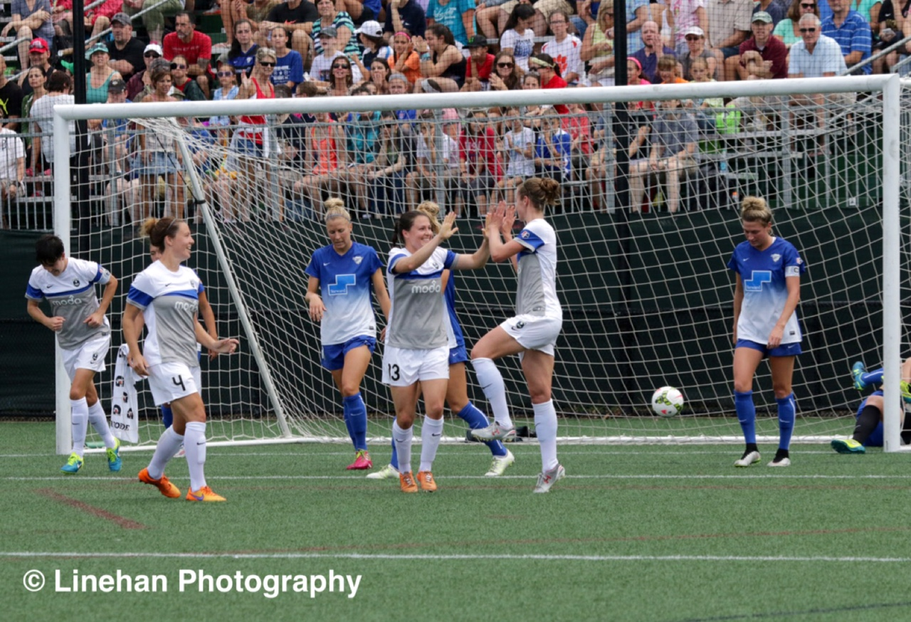 Seattle Reign FC players celebrate Beverly Yanez's goal. (Photo Copyright Clark Linehan for The Equalizer)