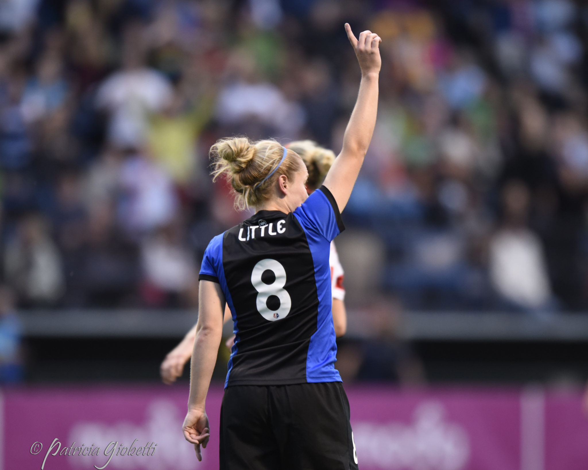 Kim Little had a hat trick on Friday night in Houston.