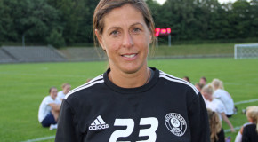 Why are female coaches still a rarity in women's soccer?