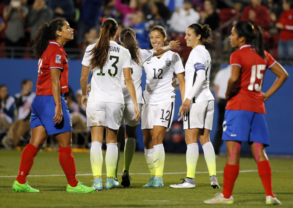 The U.S. women are one win from the Olympics. Is the system of jamming five games into 11 days really the best way to hold qualification? (AP Photo)