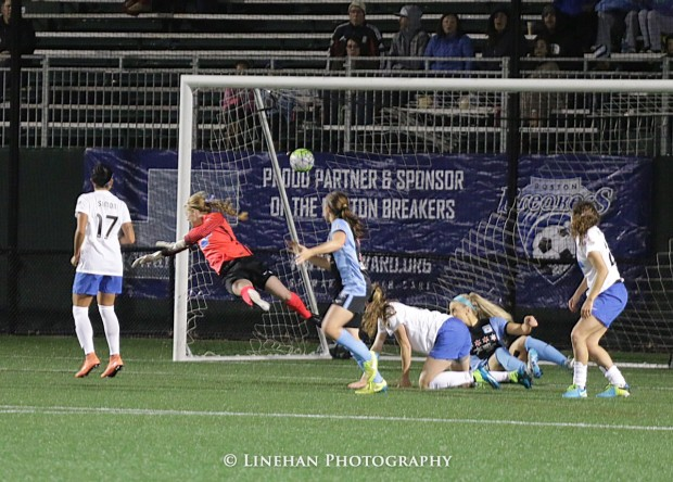 Libby Stout dives to no avail as Christen Press's goal eludes her Saturday night on Boston. (photo copyright Linehan Photography for The Equalizer)