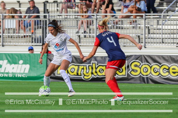 Shea Groom and Megan Oyster size each other up during the Spirit's July 2 win over FC Kansas City (photo copyright EriMac Photo for The Equalizer)