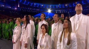 Soccer players take in Opening Ceremony from afar