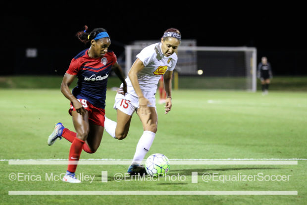 Crystal Dunn, left, battles Jaelene Hinkle during the most recent Spirit-Flash meeting, a 1-1 draw in Washington (photo copyright EriMac Photo for The Equalizer)