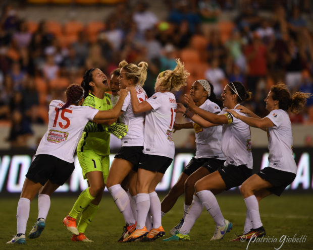 Teammates rush to mob Sabrina D'Angelo after her third PK save gave the Flash the 2016 NWSL Championship (photo copyright Patricia Giobetti for The Equalizer)