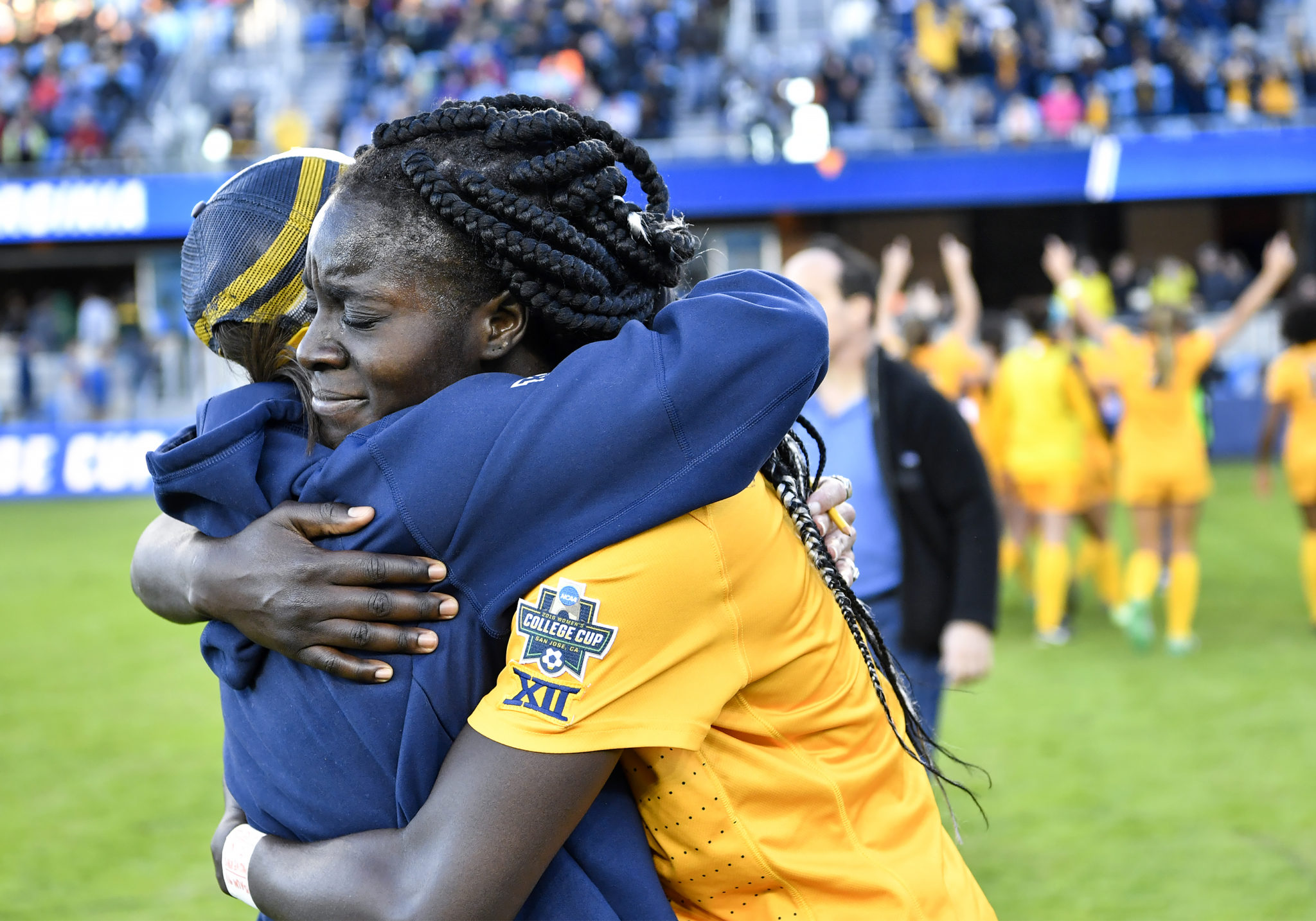 Michaela Abam hugs head coach NIkki Izzo Brown after the final whistle. Photo courtesy WVU Athletic Communications/Jenny Shephard Photo