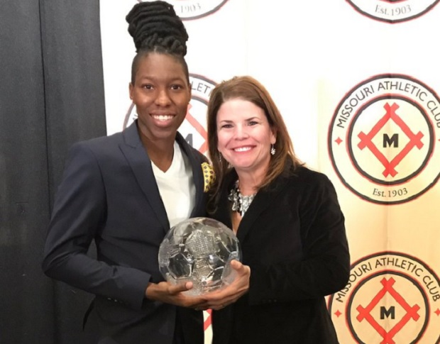 Kadeisha Buchanan poses with the MAC Hermann Trophy and Nikki Izzo-Brown, head coach of WVU. (photo courtesy WVU Women's Soccer)