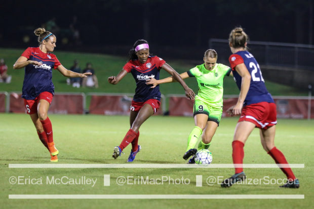 Merritt Mathias fight off a trio of Washington Spirit defenders (photo copyright EriMac Photo for The Equalizer)