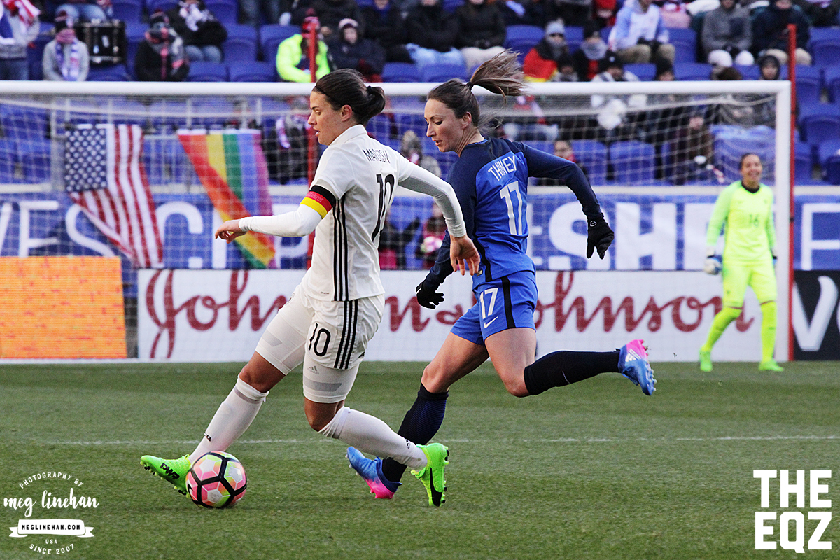 Marozsan works on getting past France's Gaetane Thiney, who subbed in for Camile Abily in the midfield. (MEG LINEHAN/Equalizer Soccer)