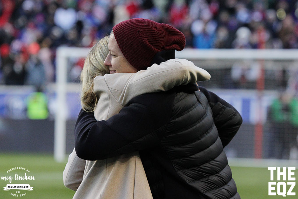 Abby Wambach and Christie Rampone hug during the ceremony for Rampone. (MEG LINEHAN/Equalizer Soccer)