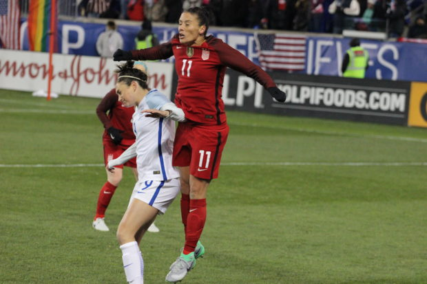 Ali Krieger goes up for a header against Jodie Taylor in the SheBelieves Cup (photo: Chelsey Bush for The Equalizer)