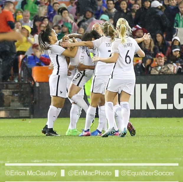 Eugenie Le Sommer is mobbed after giving France a 2-0 lead inside 10 minutes on Tuesday (photo copyright EriMac Photo for The Equalizer)