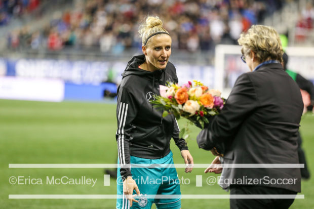 Anja Mittag is honored on the occasion of her 150th cap for Germany (photo copyright EriMac Photo for The Equalizer)
