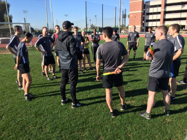 Alex Prus, in jacket, addresses a group of assistant referees ahead of their on-field training at the integrated PRO camp (photo: Dan Lauletta for The Equalizer)