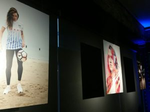Some of the Red Stars newest promo pictures hang in The Annex at the jersey reveal party. (photo by Sandra Herrera)
