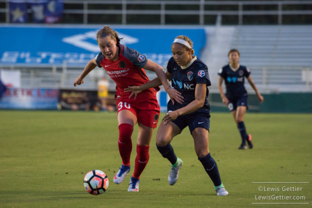 Jess McDonald (right) tries to get by Celeste Boureille in the first ever home match for the North Carolina Courage (photo copyright Lewis Gettier)
