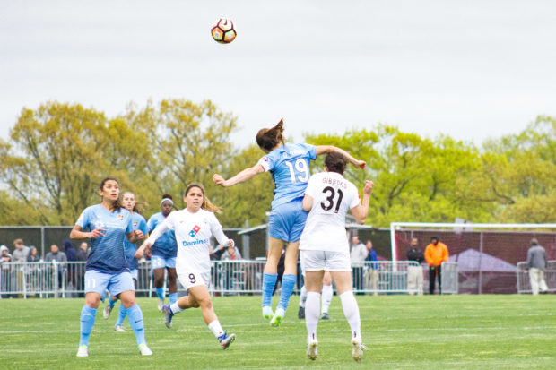 Kelley O'Hara (19) in one of her many battles with Christina Gibbons during Sky Blue's 1-0 win over FC Kansas City (photo copyright Katie Cahalin for The Equalizer)