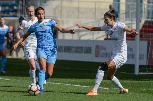 Jenn Hoy taking on Yael Averbuch in April 2017 as the Red Stars secured their first win against Kansas City at Toyota Park. (ISI Photos)