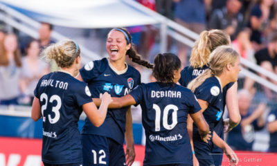 NC Courage forward Ashley Hatch (12) celebrates her goal with NC Courage forward Kristen Hamilton (23) and NC Courage midfielder Debinha (10) during a match between the NC Courage and the Boston Breakers in Cary, NC in Week 9 of the 2017 NWSL season. (Photo copyright Lewis Gettier)
