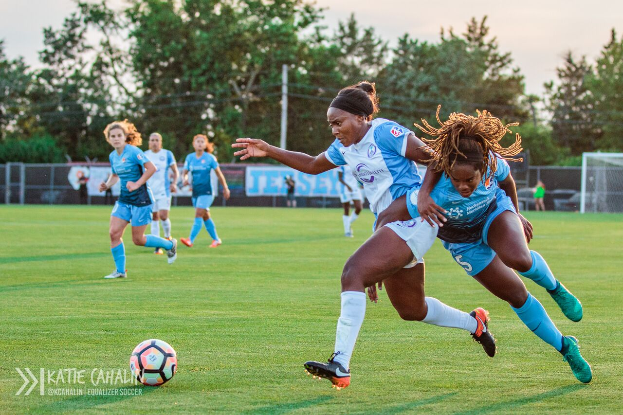 Kayla Mills gets wrapped up with Jamia Fields as she attempts to slow the Pride attack. (photo copyright Katie Cahalin for The Equalizer)