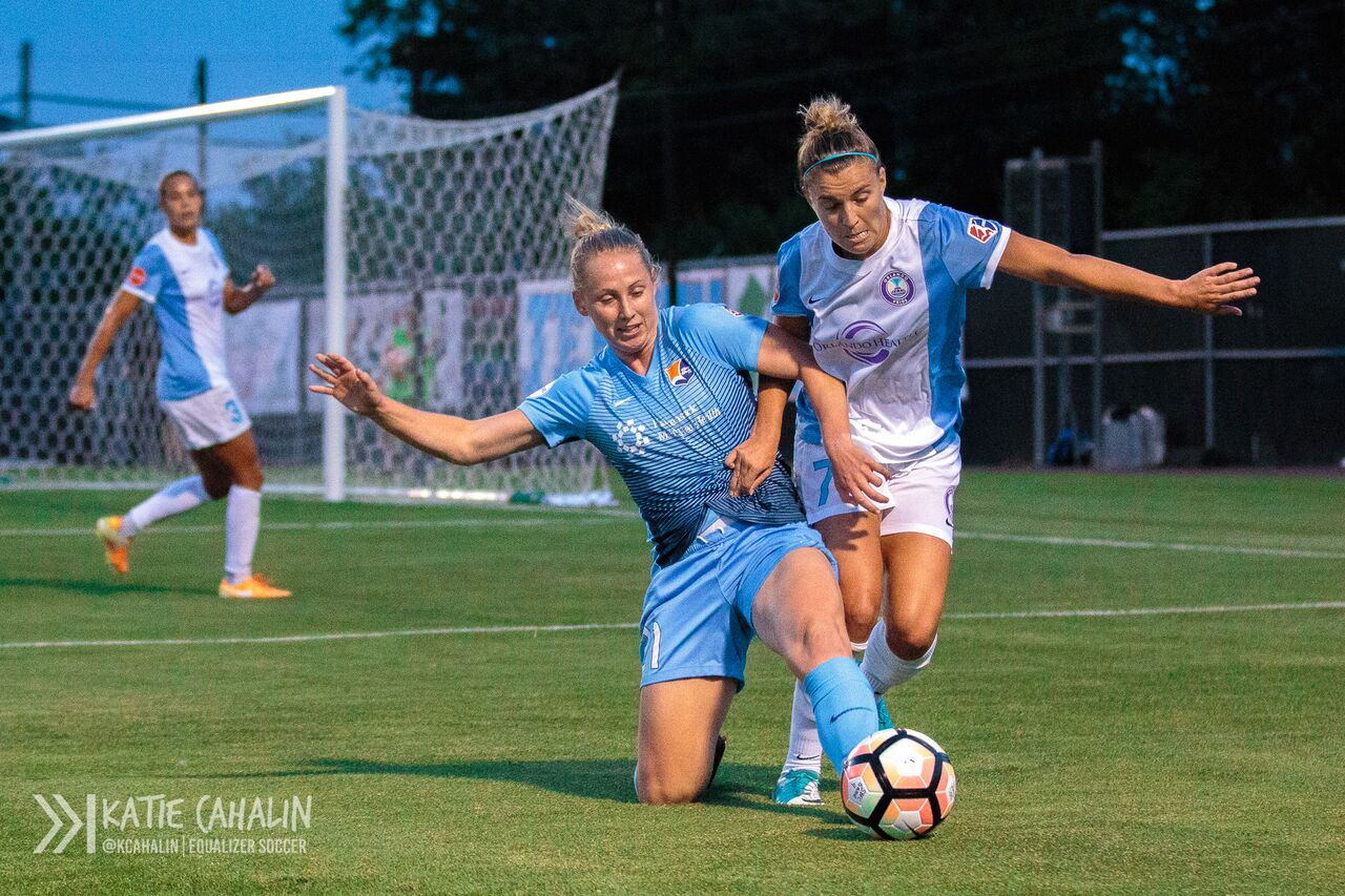 Leah Galton tries to fight off Steph Catley. (photo copyright Katie Cahalin for The Equalizer)