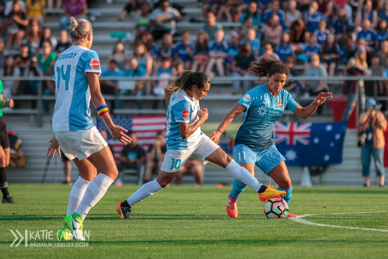 Five-time FIFA Player of the Year Marta and 2016 NWSL Rookie of the Year Raquel Rodriguez battle for possession. (photo copyright Katie Cahalin for The Equalizer)