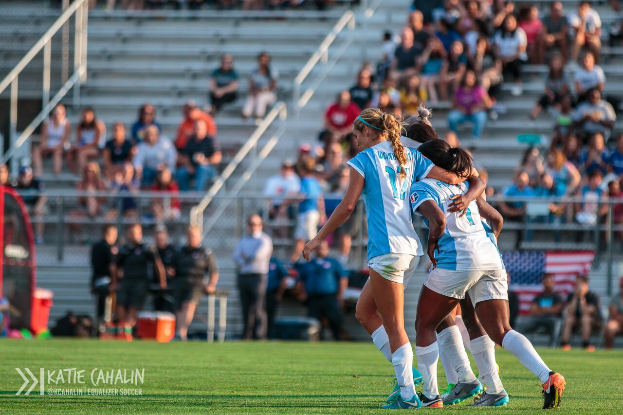Dani Weatherholt and Jamia Fields hug Chioma Ubogagu after her goal in the 11th minute. (photo copyright Katie Cahalin for The Equalizer)