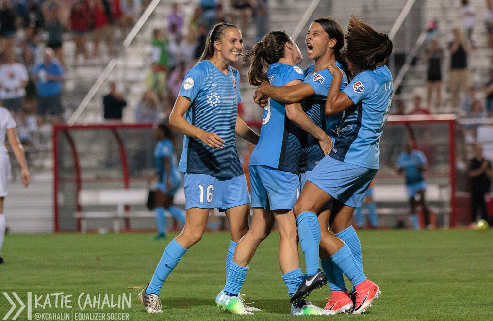 Players celebrate a Sam Kerr goal during Sky Blue FC's 100th regular-season game. (photo copyright Katie Cahalin for The Equalizer)