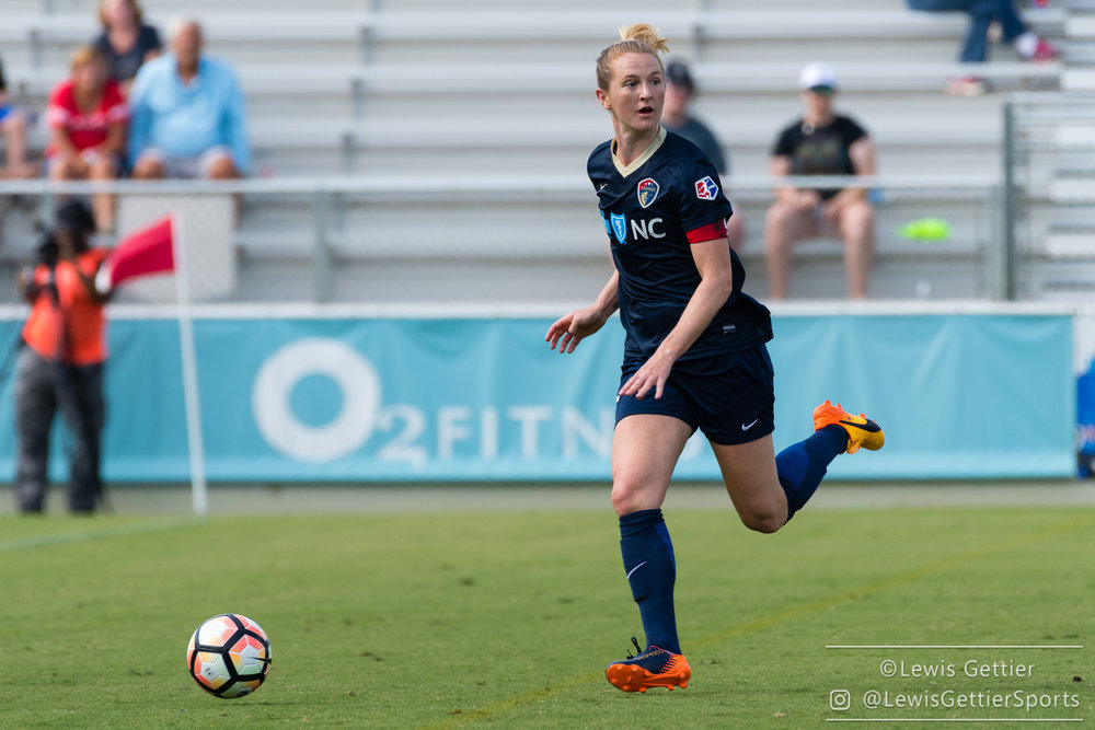 Sam Mewis looks for a target during a match between the NC Courage and the Chicago Red Stars. (photo by Lewis Gettier)