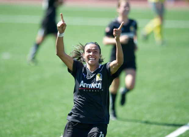Marta, shown here celebrating the 2010 WPS Championship with FC Gold Pride, is set to join the Orlando Pride.