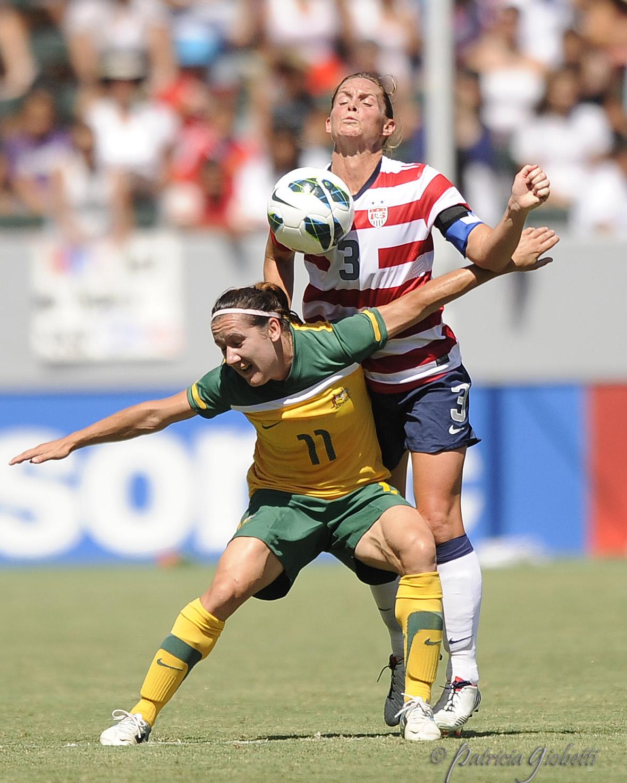 Lisa DeVanna (left) of Australia battles U.S. captain Christie Rampone for the ball. (Copyright Patricia Giobetti | http://www.printroom.com/pro/psgiobetti)
