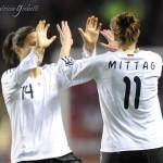 Dzsenifer Marozsan (left) and Anja Mittag celebrate Mittag's goal